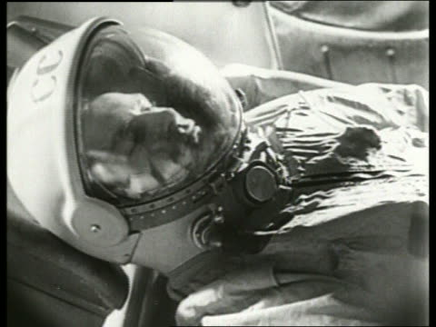 b/w 1965 close up soviet cosmonaut in spacesuit in spacecraft / aleksei leonovfirst man to walk in space - 1965 stock videos & royalty-free footage