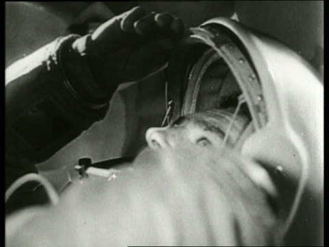 b/w 1965 close up soviet cosmonaut seals helmet in spacecraft / aleksei leonovfirst man to walk in space - 1965 stock videos & royalty-free footage
