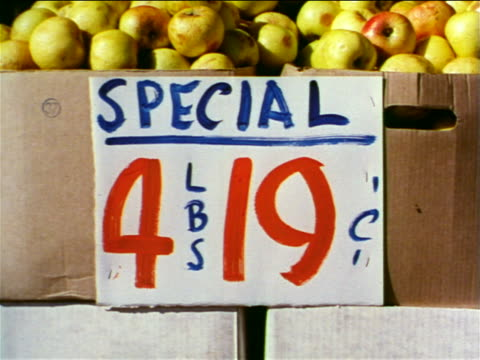 "1962 close up ""Special 4LBS 19cents"" on box of fruit / industrial"