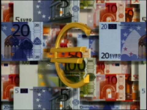 cgi close up spinning euro coin changing into eu symbol with euro bills passing in background - european union coin stock videos & royalty-free footage