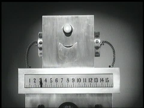 B/W 1940 close up square-headed robot talking