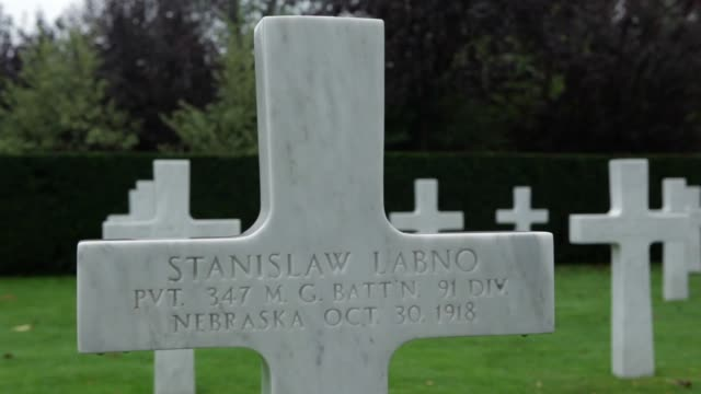 close up stanislaw lebno gravestone flowers and flags on the grave of private stanislaw labno from nebraska at the cemetery in flanders where... - gravestone stock videos & royalty-free footage