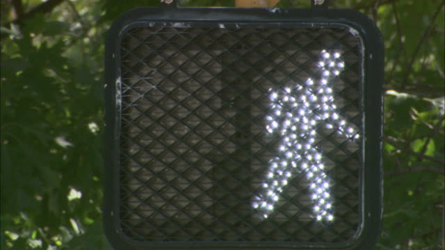 close up static - a crosswalk light switches from the symbol for stop to the symbol for go / austin, texas, usa - walk don't walk signal stock videos and b-roll footage
