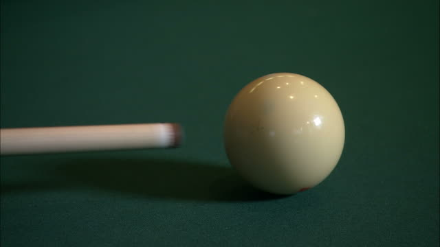 close up static - a pool cue strikes a cue ball /  wisconsin, united states - pool cue sport stock videos & royalty-free footage