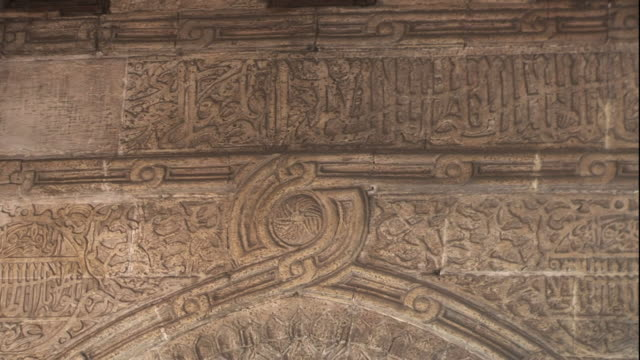 Close Up, static - Elaborate calligraphy is etched into a wall / Egypt