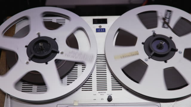 Close up static shot of a 'Struder' reel to reel film player during playback