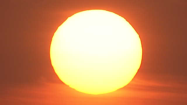 close up static - the sun shines in an orange sky.  - heat stock videos & royalty-free footage
