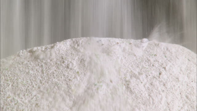 close up static - white powder falls onto a pile /  kansas, united states - powder stock videos & royalty-free footage