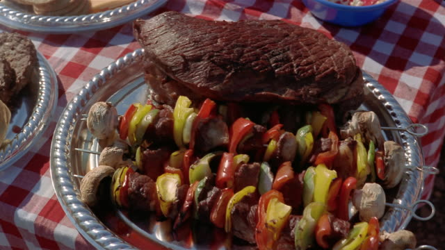 close up steak and kabobs on table at tailgate party/ connecticut - skewer stock videos & royalty-free footage