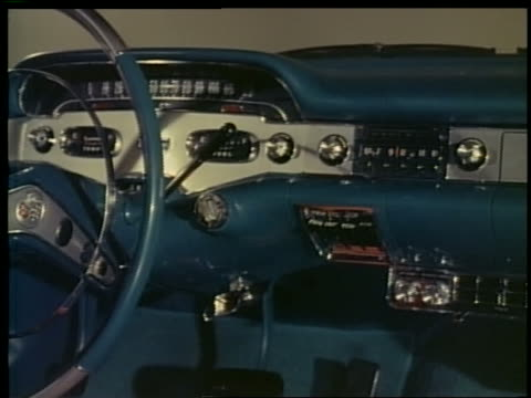 vídeos de stock e filmes b-roll de 1957 close up pan steering wheel + dashboard of blue chevrolet impala - general motors
