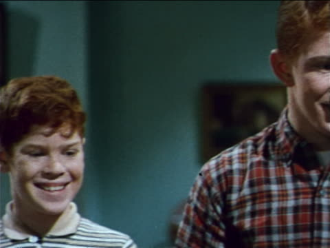 1962 close up PAN step-and-stairs redheaded boys smiling / industrial