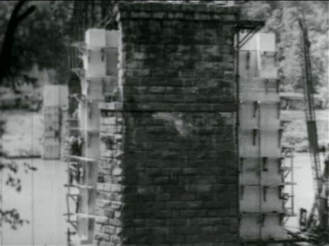 close up stone support of bridge under construction by wpa / documentary - anno 1934 video stock e b–roll