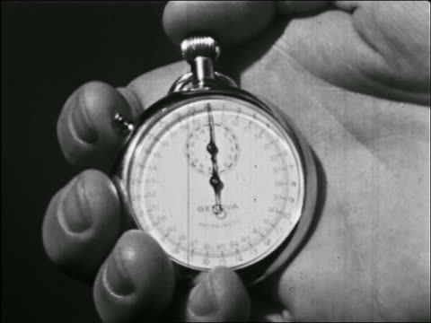 b/w close up stopwatch being started - stop watch stock videos & royalty-free footage