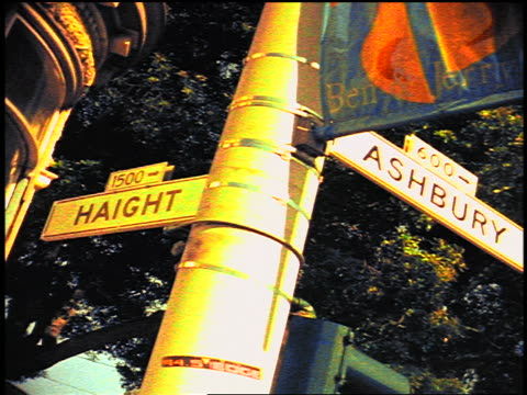 distorted close up street signs at intersection of haight-ashbury / san francisco - 道路名の標識点の映像素材/bロール