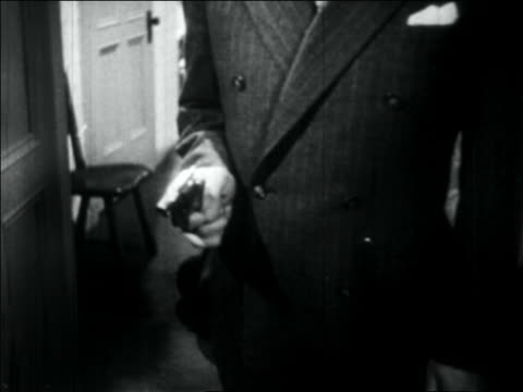 b/w 1934 close up suit-wearing gangster's hand shooting pistol - handgun stock videos and b-roll footage