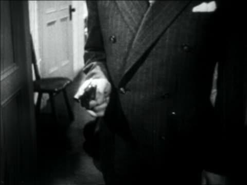 b/w 1934 close up suit-wearing gangster's hand shooting pistol - handgun stock videos & royalty-free footage