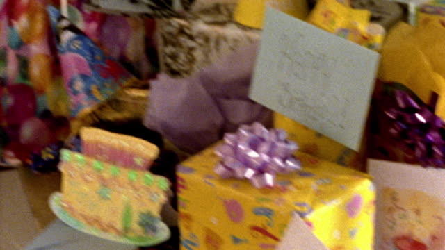 close up pan table full of birthday gifts - war in afghanistan: 2001 present stock-videos und b-roll-filmmaterial