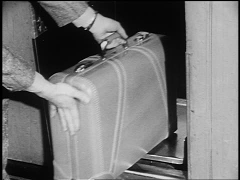 b/w 1951 close up teen boy's hands putting luggage on scale at ticket counter in midway airport - ticket counter stock videos & royalty-free footage