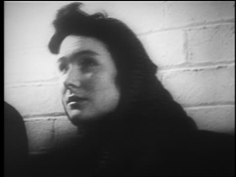 vidéos et rushes de b/w 1940 close up teen girl in babushka looking up in subway station / london blitz / educational - 1940