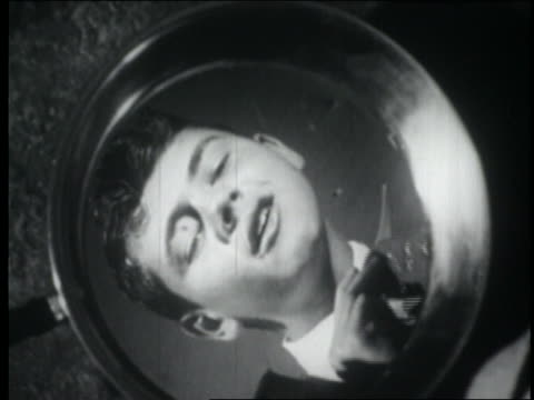 b/w 1949 close up teenage boy looking at reflection in mirror as he puts on tie - 1949 stock videos & royalty-free footage