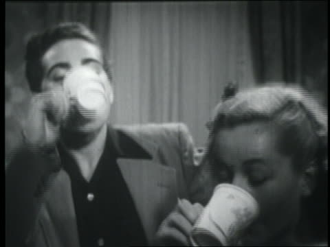 b/w 1951 close up teenage couple drinking from paper cups while dancing - 1951 stock videos & royalty-free footage