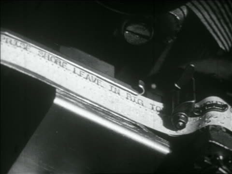 B/W 1956 close up telegraph tape with words + punch marks spooling from machine
