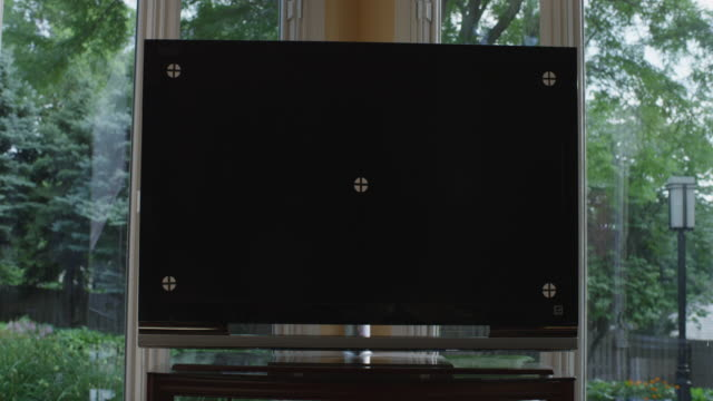 Close up television monitor with tracking marks in the family room of a home.