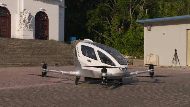 Close up the blades spin on an EHang Inc E184 drone at the company's headquarters in Guangzhou China on Thursday Nov 2 Close up the blades on an...