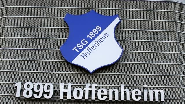 stockvideo's en b-roll-footage met close up the logo of tsg 1899 hoffenheim is seen in front of the wirsol rheinneckar arena prior to the bundesliga match between tsg 1899 hoffenheim... - 1899