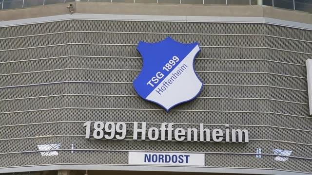 close up, the logo of tsg 1899 hoffenheim is seen in front of the wirsol rhein-neckar arena prior to the bundesliga match between tsg 1899 hoffenheim... - 1899 bildbanksvideor och videomaterial från bakom kulisserna