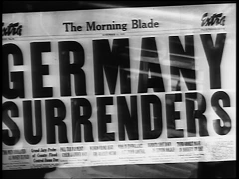 vídeos y material grabado en eventos de stock de close up the morning blade newspaper headline: germany surrenders - el fin