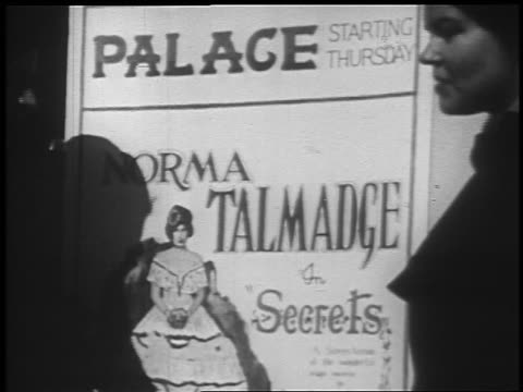 vidéos et rushes de b/w 1925 close up theater poster advertising norma talmadge film / newsreel - 1925