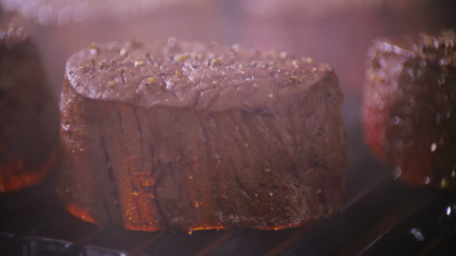 close up thick beef steaks on the grill with spices and smoke. - tenderloin stock videos and b-roll footage