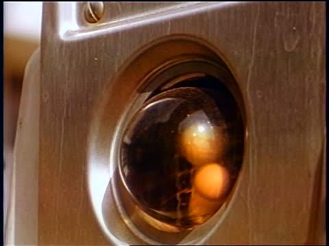 1958 close up three balls blowing around in glass globe / pinwheels spinning in wind / newsreel - einige gegenstände mittelgroße ansammlung stock-videos und b-roll-filmmaterial