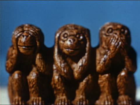 1953 close up three monkey figurines in 'see no evil, hear no evil, speak no evil' pose - gossip stock videos & royalty-free footage