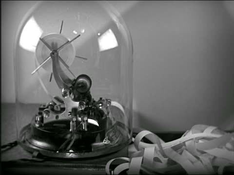 b/w close up ticker tape machine running - ticker tape stock videos and b-roll footage