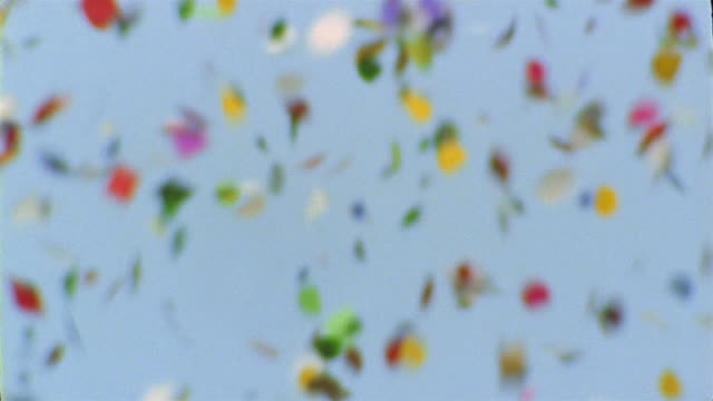 close up ticket tape falling through clear blue sky / new york city - confetti stock videos & royalty-free footage