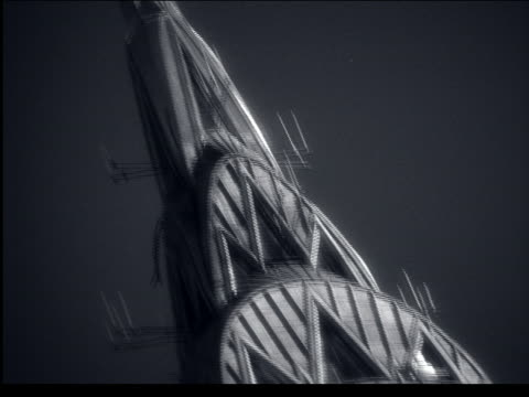 b/w close up tilt down from top of chrysler building / nyc - chrysler building stock videos & royalty-free footage