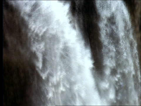 close up tilt down from top to bottom of waterfall