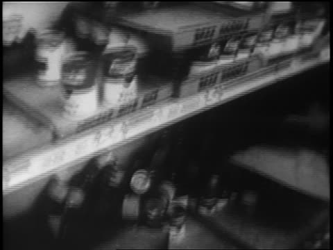 b/w 1962 close up tilt down grocery store shelves with few cans of soup left during cuban missile crisis - cuban missile crisis stock videos & royalty-free footage