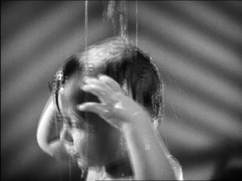 b/w 1948 close up tilt down hands of mother bathing baby with sponge / michigan / medical industrial - 1948 stock-videos und b-roll-filmmaterial
