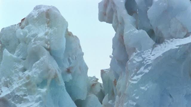 close up tilt down pinnacle of iceberg along crevice to base / arctic - nick berg stock videos & royalty-free footage