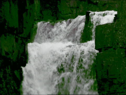 close up tilt down waterfall with green colored rocks / high force, teesdale, england - teesdale stock videos & royalty-free footage