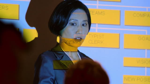 close up tilt up asian businesswoman giving presentation in front of projection with chart in meeting - seminar stock videos & royalty-free footage