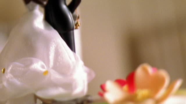 Close up tilt up Black bride and groom cake decoration