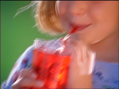 close up tilt up blonde girl drinking red beverage with straw - endast flickor bildbanksvideor och videomaterial från bakom kulisserna