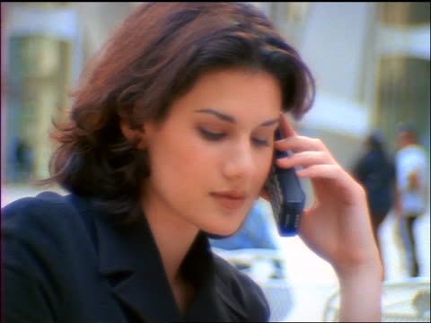 close up tilt up businesswoman with laptop sitting outdoors talking on cellular phone + raising fist in victory - 1998 stock videos & royalty-free footage