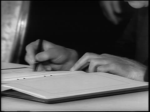 b/w 1963 close up tilt up hands of lord hume signing atomic test ban treaty / newsreel - treaty stock videos and b-roll footage