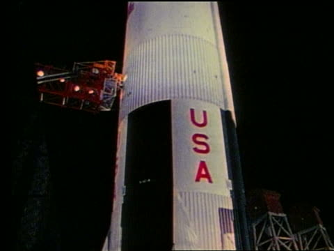 close up tilt up of apollo 17 rocket at night - 1972 stock videos & royalty-free footage