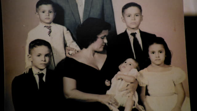 vídeos y material grabado en eventos de stock de close up tilt up portrait archival photograph of family with mother holding baby - fotografía temas